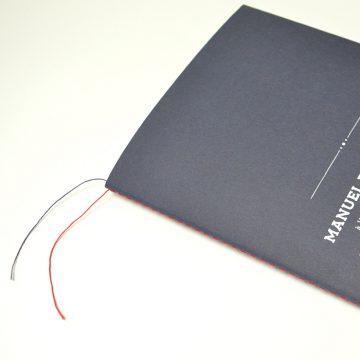 couture avec fil dépassant